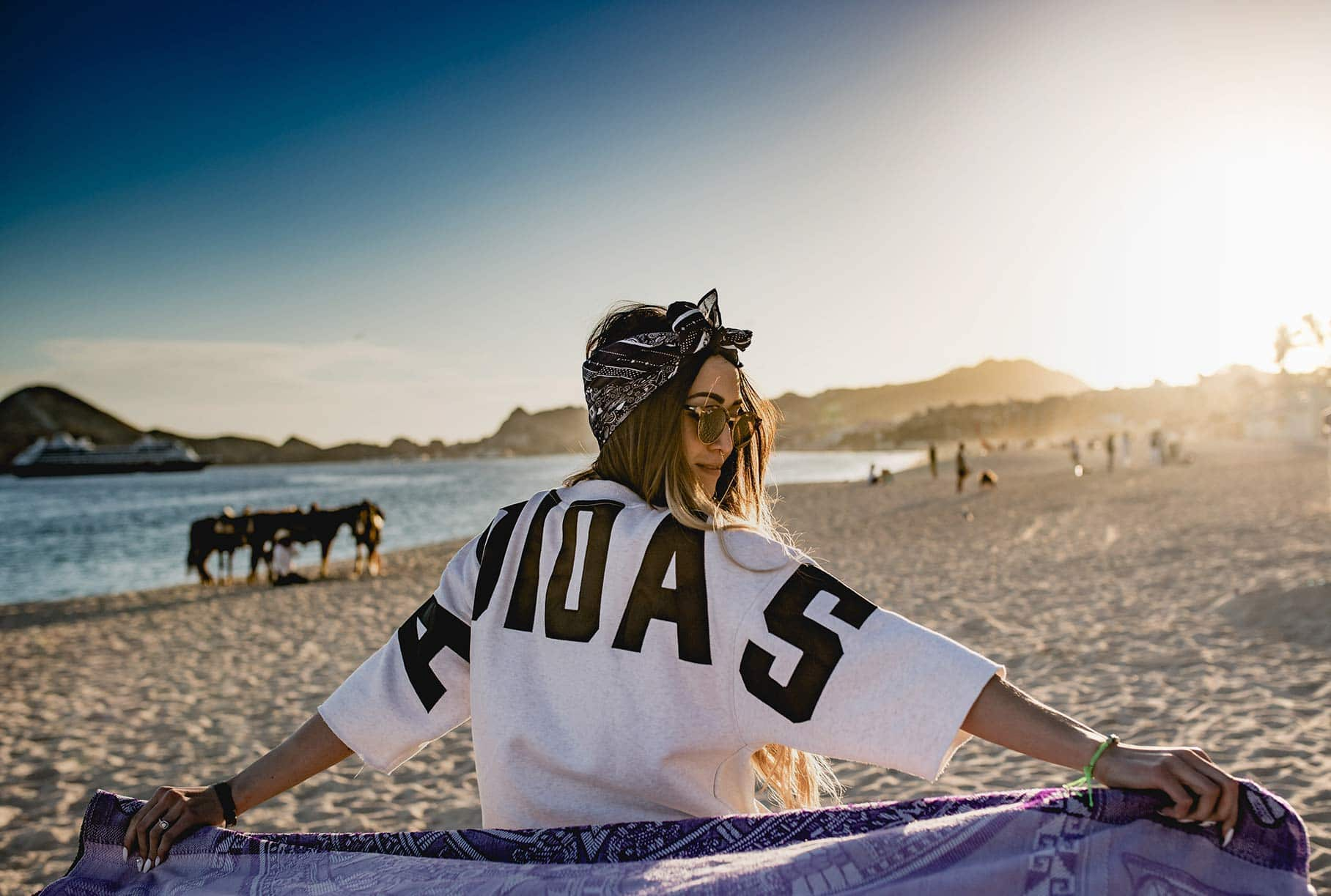 girl on the beach with towel